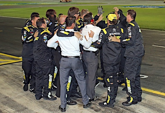 Members of Joe Gibbs Racing huddle up after winning the 600. (RacinToday/HHP photo by Alan Marler)