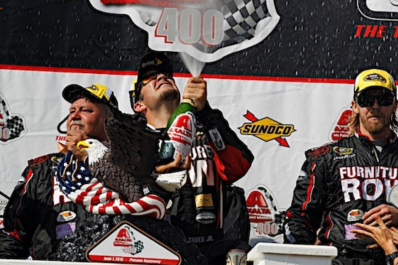 Martin Truex Jr. got to spray champagne for NASCAR's little guys last Sunday.  (RacinToday/HHP photo by Andrew Coppley)