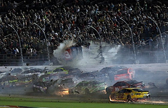 Austin Dillion's car slams into the catch fence at the end of the Coke 400 at Daytona International Speedway  (RacinToday/HHP photo by Andrew Coppley)