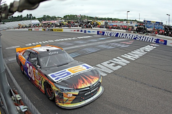Denny Hamlin takes the checkered flag in Saturday's XFINITY Series race in New Hampshire. (RacinToday/HHP photo)