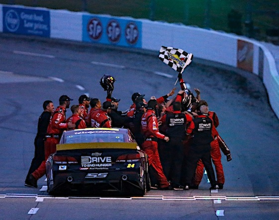 Jeff Gordon and his Hendrick Motorsports team celebrate Sunday's victory at Martinsville Speedway. (RacinToday/HHP photo by Andrew Coppley)