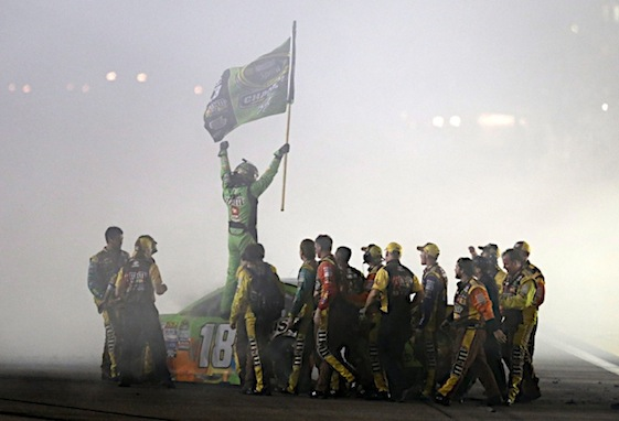 Kyle Busch celebrates with his Joe Gibbs Racing team after winning Sunday in Homestead. (RacinToday/HHP photo Garry Eller)