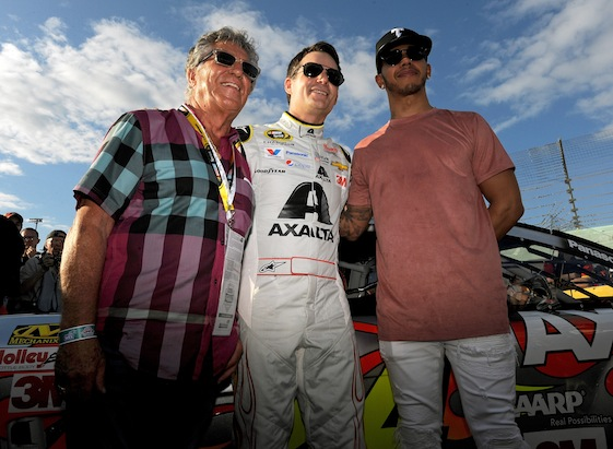 F1 world champions Mario Andretti and Lewis Hamilton were among the Jeff Gordon fans who watched the four-time Cup champion's last race on Sunday. (Photo by Jared C. Tilton/NASCAR via Getty Images)