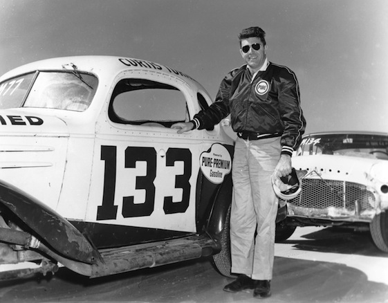 Curtis Turner poses with the car he drove to a second-place finish in the NASCAR Modified-Sportsman race on the Daytona Beach-Road Course. (Photo by ISC Images & Archives via Getty Images)