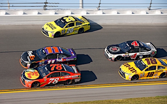 The No. 78 Furniture Row Racing Toyota nosed ahead of the No. 11 Toyota of Denny Hamlin as the lead pack came through the final turn in last Sunday's Daytona 500. (RacinToday/HHP Photo by Alan Marler)