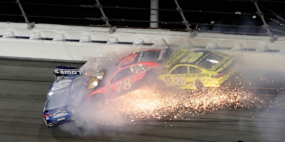 Jimmie Johnson (48), Martin Truex Jr. (78) and Matt Kenseth (20) wreck during the second Can-Am Duel at the at the Daytona International Speedway on Thursday. (RacinToday/HHP photo by Tom Copeland)