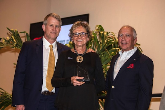 Judy Stropus, flanked by Bobby Akin and Archie Urciuoli, was honored by the Sport Car Drivers Club of America at Daytona. (Photo by Brian Cleary)