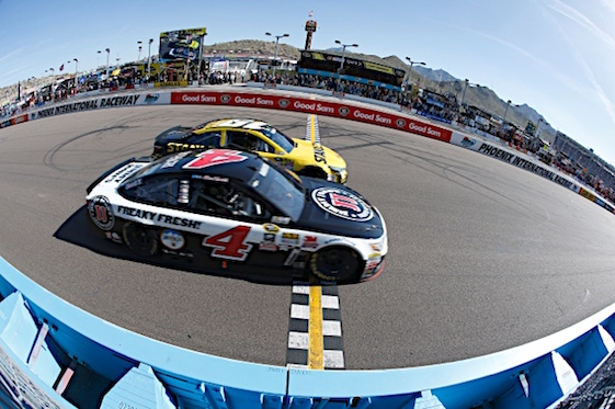 Kevin Harvick nosed across the finish line ahead of Carl Edwards to win the Good Sam 500 at the Phoenix International Speedway on Sunday.  (RacinToday/HHP photo by Andrew Coppley)