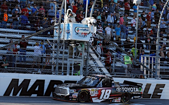 Kyle Busch takes checkered flag in the Camping World Truck Series Race at Martinsville on Saturday. (RacinToday/HHP photo by Andrew Coppley)