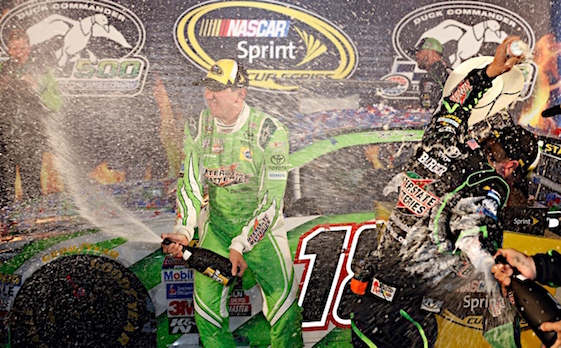 Kyle Busch administered a champagne show to those in Victory Lane after winning Saturday night's Sprint Cup race at Texas Motor Speedway. (RacinToday/HHP photo by Andrew Coppley)
