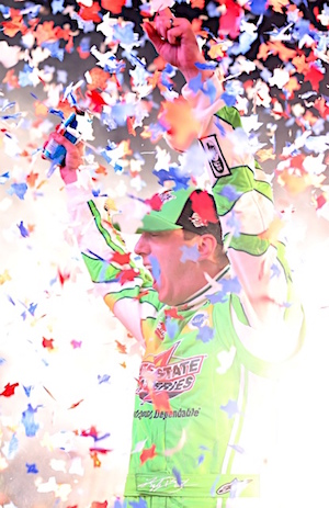 Kyle Busch made his way to Victory Lane for a second straight night Saturday when he won the Sprint Cup race at TMS. (RacinToday/HHP photo by Ashley R Dickerson)