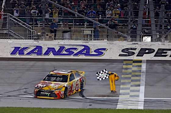 Kyle Busch on Friday night finally was able to take one of his signature victory bows at Kansas Speedway. (RacinToday/HHP photo by Alan Marler)