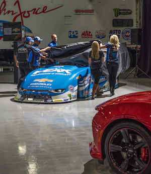 Members of the John Force Racing team unveiled the new generation Chevrolet Camaro Funny Car on Tuesday in Brownsburg, Ind.