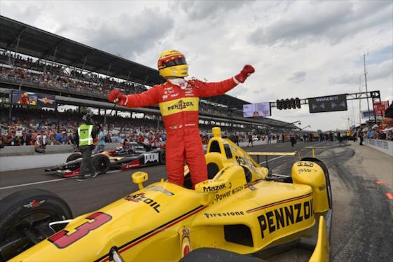 Team Penske's Helio Castroneves celebrates victory in the pit crew competition.