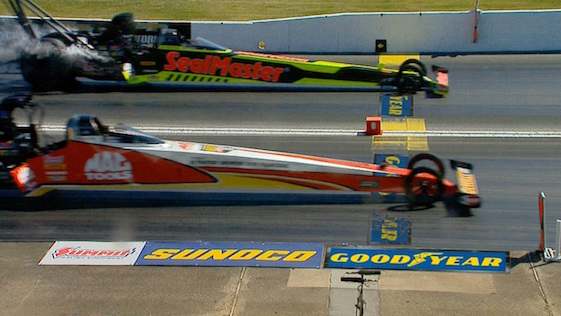 Last time out, Doug Kalitta, front, edged teammate J.R. Todd in the finals at Atlanta.
