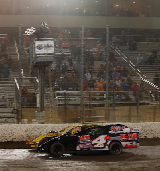 The finish of Saturday night's dirt race at Texas Motor Speedway was as close as they get.