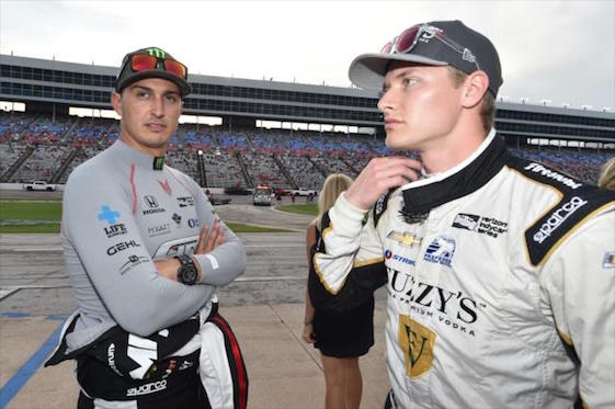 Drivers Graham Rahal and Josef Newgarden joined fans in waiting out the start of Saturday's IndyCar Series race in Texas.