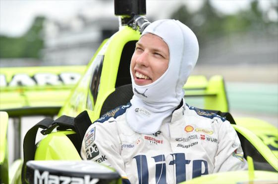 NASCARA champion Brad Keselowski squeezed into the cockpit of a Team Penske Indy car to take laps at Road America on Wednesday.