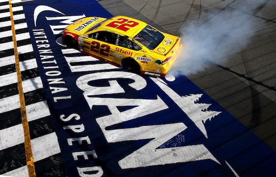 Joey Logano celebrates his victory Sunday at Michigan International Speedway.  (Photo by Sean Gardner/NASCAR via Getty Images)