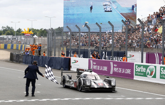 Neel Jani takes the checkered flag in the No. 2 Porsche 919 Hybrid at Le Mans on Sunday. The victory was a stunner. (Photos courtesy of Porsche North America)