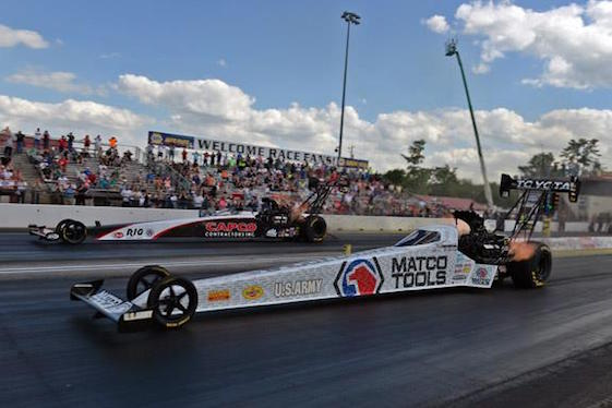 Antron Brown, foreground, edged Steve Torrence in the finals of Monday's rain-delayed New EnglandNationals.