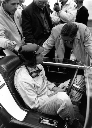 Don Frey gives Dan Gurney instructions before a high-speed racetrack demonstration of the Mustang I at Watkins Glen prior to the US Grand Prix in 1962. Roy Lunn's work on the prototype earned him the job of chief engineer on the Ford GT program.