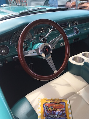 "The interior of Bobby Coln's 1955 Pontiac Safari station wagon features new ""ultra leather"" seats while retaining its classic metal dash, albeit with a late-model steering wheel."