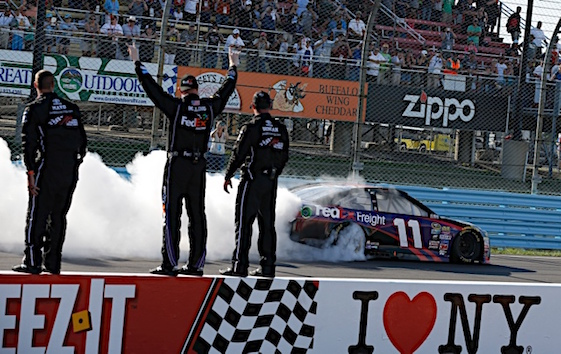 Denny Hamlin and his team celebrate their victory at Watkins Glen on Sunday. Hamlin experienced the agony of victory in the race. (RacinToday/HHP photo by Andrew Coppley)