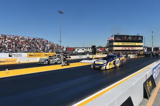 John Force held Ron Capps to win the Funny Car portion of Sunday's NHRA event in Sonoma, Calif.