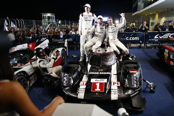 Winners of Saturday's World Endurance Championship race in Texas celebrate with their car.