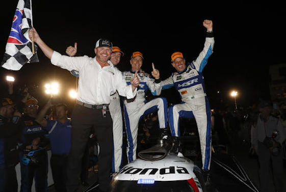 Members of the Michael Shank Racing team celebrate their in in Saturday's Petit Le Mans at Road Atlanta. (Michael L. Levitt LAT Photo USA)