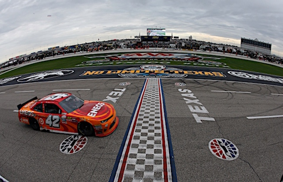 Kyle Larson takes the checkered flag to win Saturday's Xfinity Series Race at Texas Motor Speedway. (RacinToday/HHP photo by Andrew Coppley)